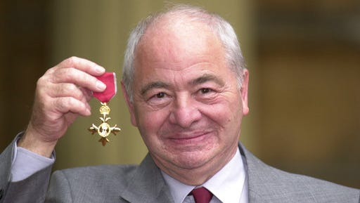 FILE - This is a Oct. 27, 2000  file photo of British  author Colin Dexter after receiving an Order of the British Empire. Writer Colin Dexter, who created music-loving Oxford detective Inspector Morse, has died aged 86. Publisher Pan Macmillan said  Dexter died Tuesday March 21, 2017  at his home in Oxford England.