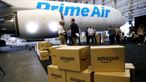 "FILE - In this Thursday, Aug. 4, 2016, file photo, Amazon.com boxes are shown stacked near a Boeing 767 Amazon ""Prime Air"" cargo plane on display in a Boeing hangar in Seattle. Retail subscription programs, such as Amazon Prime, promise free shipping to members for a monthly or yearly fee. As shoppers demand speed, some cyberstores are offering free and fast shipping, albeit with minimum-purchase requirements. Certain situations, however, may warrant paying the membership fee."