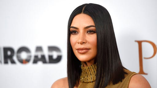 """FILE - In this April 12, 2017, file photo, Kim Kardashian West arrives at the U.S. premiere of """"The Promise"""" at the TCL Chinese Theatre in Los Angeles. Kardashian West tells Ellen DeGeneres on the April 27, 2017, episode of the comedian's chat show that she's """"such a different person"""" after being held at gunpoint during a Paris jewelry heist last year."""