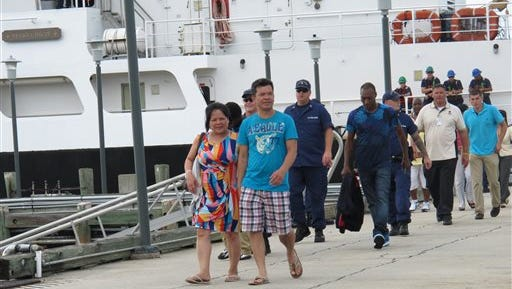 Passengers return to land at the Coast Guard station on Tybee Island, Ga., on Wednesday after being stranded overnight on a casino boat that ran aground off the Georgia coast. More than 120 passengers and crew were aboard the Escapade casino boat when got stuck on rocks late Tuesday. The Coast Guard took them off the ship and onto rescue boats Wednesday afternoon.