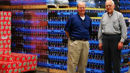 This photo provided by the The Mississippi Business Journal shows Nehi Bottling Company owners Homer Sledge Jr, right, and his son Homer Sledge III., in Cleveland, Miss. The business celebrates its 85th year in business in 2014, and while it no longer manufacturers the soft drinks, the company still employs 18 people distributing Nehi, Royal Crown (RC) Cola, Dr. Pepper, Seven Up, A & W, Country Time, Sunkist and Canada Dry products throughout its service territory.