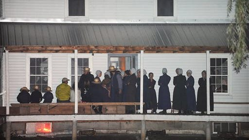 Supporters gather on the porch of a house at the intersection of Route 812 and Mt. Alone Road in Heuvelton, N.Y. on Thursday after two sisters were returned home safely after being abducted Wednesday night at a farm stand near their home.