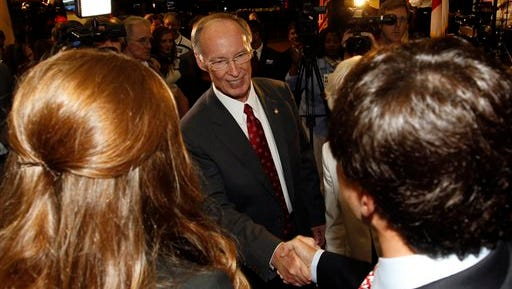 Governor Robert Bentley shakes hands with supporters at his Election Primary viewing party at Bryant Denny Stadium on Tuesday, June 3, 2014, in Tuscaloosa, Ala. (AP Photo/Butch Dill)