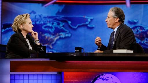 """Former U.S. Secretary of State Hillary Rodham Clinton listens to host Jon Stewart during a taping of """"The Daily Show with Jon Stewart,"""" Tuesday, July 15, 2014, in New York."""
