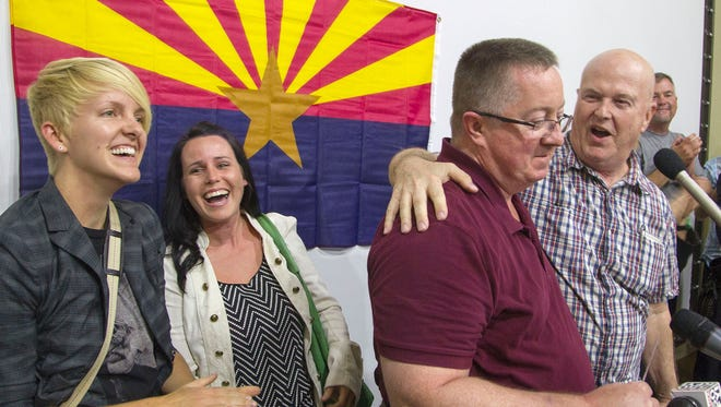 From left, Robin and Renee Reece and Joe Connolly and Terry Pochert, on Friday evening at a celebration at the Southwest Conference United Church of Christ. All were plaintiffs in one of the lawsuits to overturn Arizona's same-sex marriage ban.