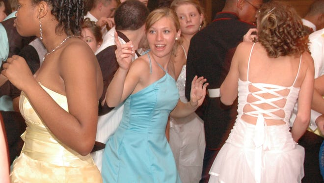 High schoolers dance in this file photo from a Woodbridge high school prom.