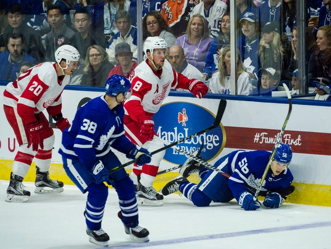 Maple Leafs left wing Trevor Moore (56) is checked
