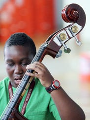 Isaiah Clay plays the bass in the MYCincinnati Glass