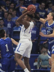 CovCath's Nick Thelen tries to block a shot during