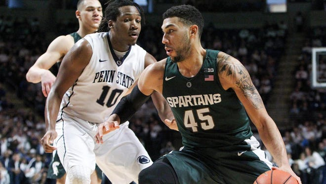 Michigan State Spartans guard Denzel Valentine (45) drives the ball to the basket as Penn State Nittany Lions forward Brandon Taylor (10) defends during the second half at Bryce Jordan Center. Michigan State defeated Penn State 92-65.