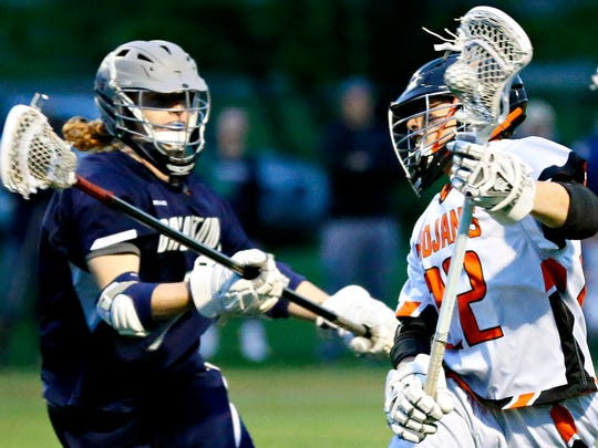 York Suburban's Dominic Corto, right, works to get past Dallastown's Ethan Eckert during lacrosse action at York Suburban High School in Spring Garden Township, Monday, April 24, 2017. Dawn J. Sagert photo