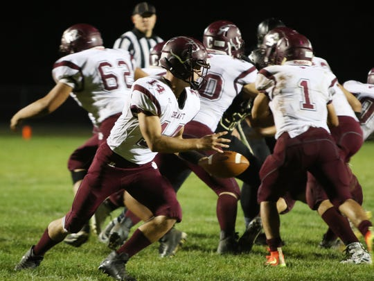 Stuarts Draft's Trevor Craig looks to hand off the ball during the first half of Friday night's game at Buffalo Gap on Oct. 6, 2017.