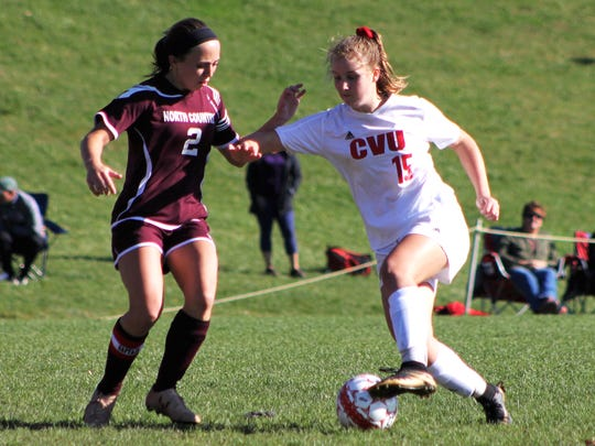 Champlain Valley's Olivia Morton looks to move the ball against North Country's Chelsea Daigle during Saturday's Division I girls soccer quarterfinal in Hinesburg.