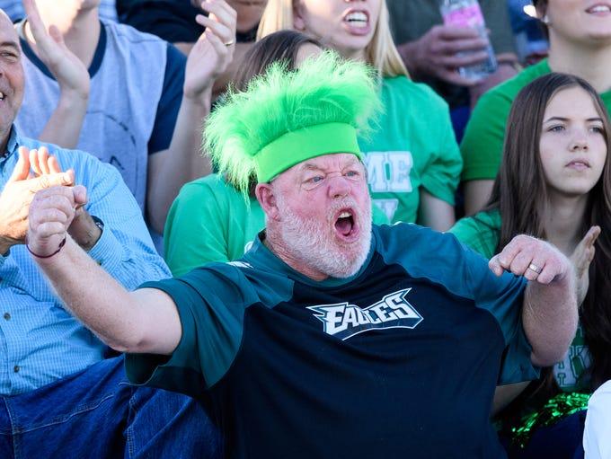 Thatcher fans celebrate their teams lead during their