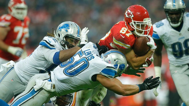 Kansas City Chiefs tight end Travis Kelce (87), right, is tackled during the NFL football game between Detroit Lions and Kansas City Chiefs Wembley Stadium in London,  Sunday, Nov. 1, 2015.