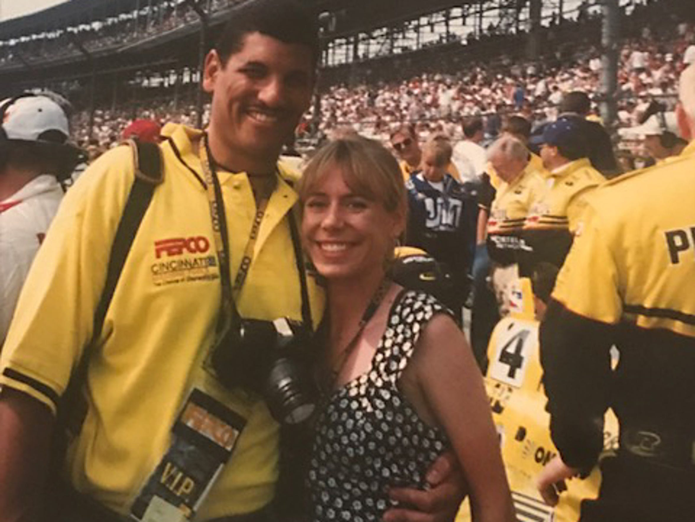Jay and Kim Norvell at an auto race while he coached