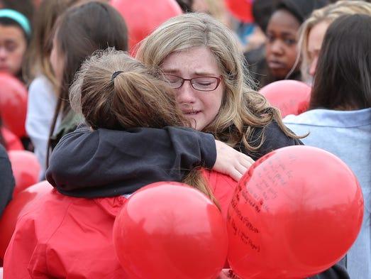 Friends and family member of slain Indiana University