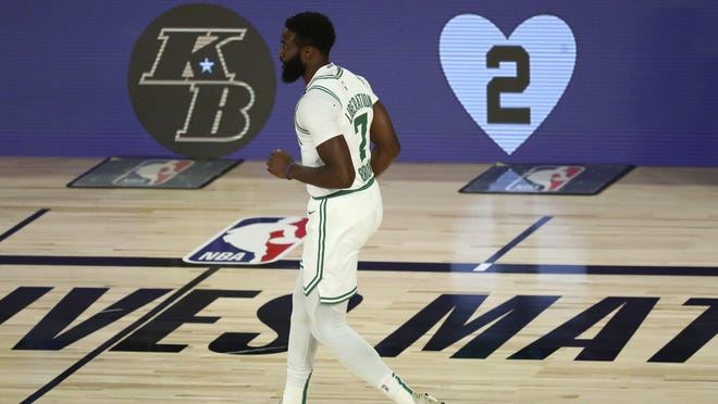 Boston Celtics guard Jaylen Brown jogs back during Game 4 vs. the Philadelphia 76ers on Sunday in Lake Buena Vista, Fla.