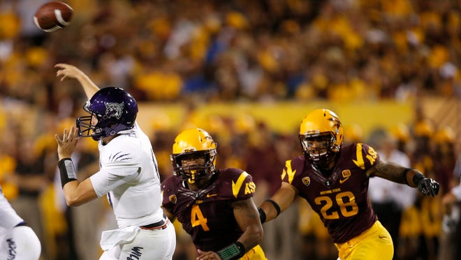 Weber State quarterback Billy Green gets a pass off before ASU linebacker D.J. Calhoun can sack him during the first quarter of ASU's season opener at Sun Devil Stadium in Tempe, Ariz. on Aug. 28, 2014.