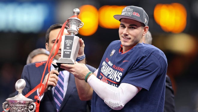 Quarterback Chad Kelly (10) accepts the trophy after being named MVP of the 2016 Sugar Bowl. He underwent surgery last week and will be out for the remainder of spring workouts.