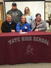 Tate High School senior Izzy Werdann signs a junior college national letter of intent to play softball for Mississippi Gulf Coast Community College in Perkinston, Miss. Izzy (center) is pictured with her parents John and Lori Werdann along with her siblings John II and Sierra.
