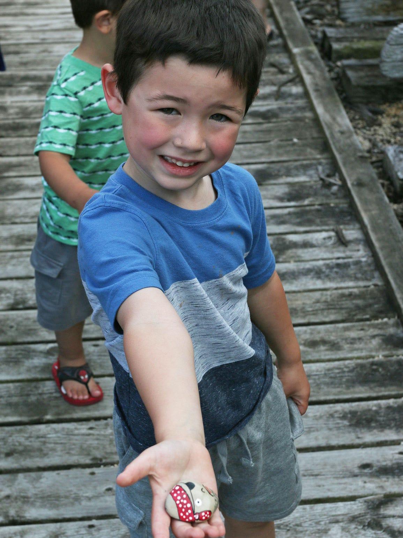 Jack Bickner, 4, holds a painted rock after finding