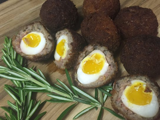Wee Scotch eggs that feature quail eggs wrapped in