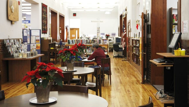 December 2012 file photo of patrons studying inside the Staunton Public Library.
