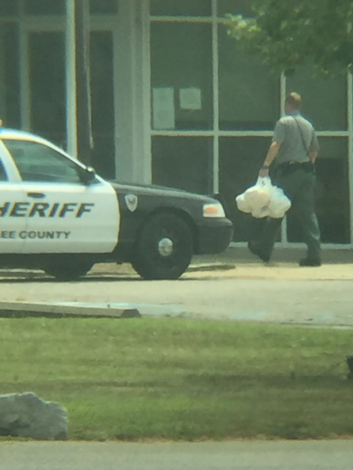 A Lee County deputy delivers food he received from