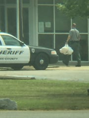 A Lee County deputy delivers food he received from a bail agent working for Corbett Bonding, which has 73 percent of the bail business in Lee County.