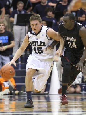 University of Indianapolis' Daniel Daudu, right, guards Butler University's Rotnei Clarke at Hinkle Fieldhouse, Nov. 3, 2012.