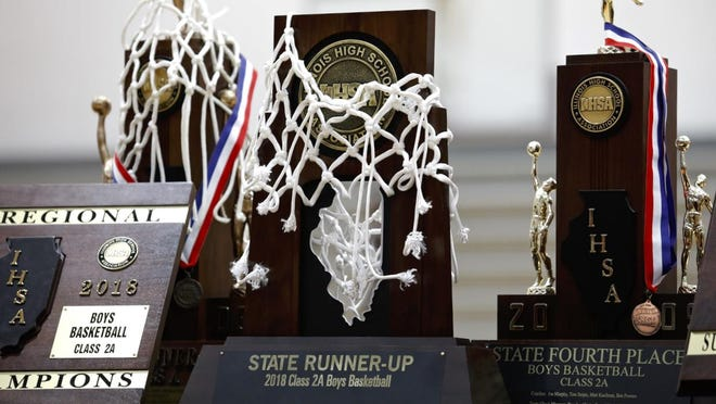 A state runner-up trophy is displayed in the gymnasium of Winnebago High School on Sunday, March 11, 2018, during a celebration pep rally for the boys basketball team placing second in the IHSA Class 2A State Championship.