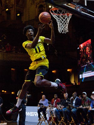 Josh Jackson competes in the slam dunk contest during the McDonald's All-American Jam Fest on March 28, 2016, in Chicago.