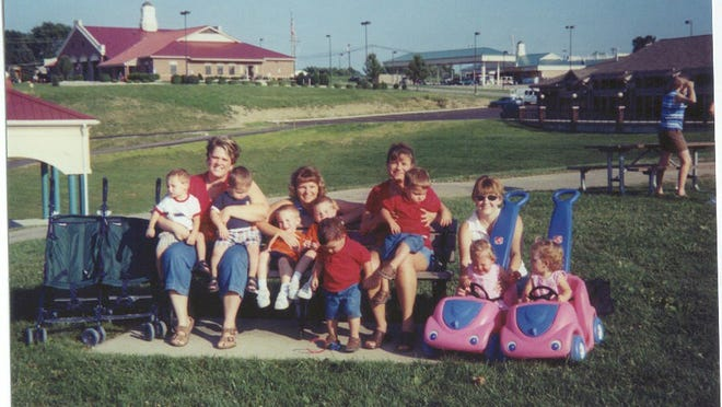 From 2006: Kasey Curee and her sons Alec and Evan; Cindy Kohler and her sons Brett and Bradley; Lori King and her sons Cody and Carson; Samantha Davis and her daughters Faith and Destiny enjoy a picnic with the Northern Kentucky Mothers of Twins Club.