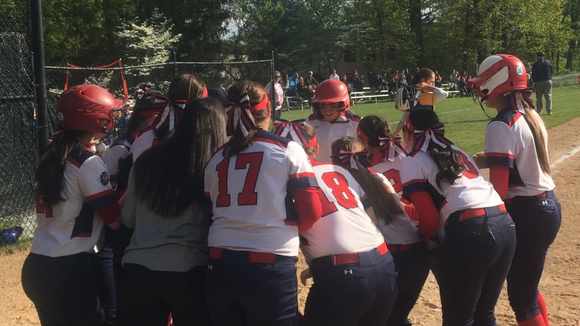 Eastchester teammates prepare to congratulate Emilie Olivier after her two-run home run against Ardsley on May 10, 2017.