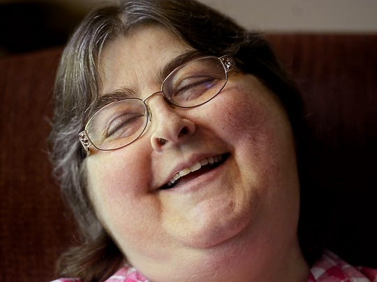 Tammy Shackett smiles as she jokes about her puffy