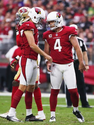 Arizona Cardinals kicker Phil Dawson (4) celebrates with holder Andy Lee (2) after a field goal against the San Francisco 49ers during the third quarter at University of Phoenix Stadium in Glendale, Ariz. October 1, 2017. The Cardinals won 18-15.