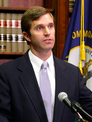 Attorney General Andy Beshear addresses the media over the University of Louisville Board of Directors during a press conference at the State Capital in Frankfort, Kentucky.  July 29, 2016