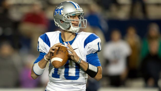 Middle Tennessee Blue Raiders quarterback Logan Kilgore looks to pass during the second half against the Brigham Young Cougars at Lavell Edwards Stadium.