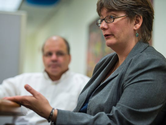 Director of Health Care Reform Robin Lunge, right,