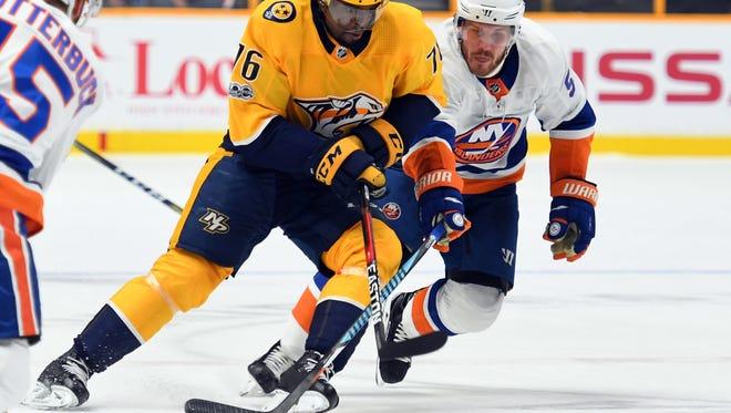 Oct 28, 2017; Nashville, TN, USA; Nashville Predators defenseman P.K. Subban (76) skates with the puck against New York Islanders center Casey Cizikas (53) during the first period at Bridgestone Arena.
