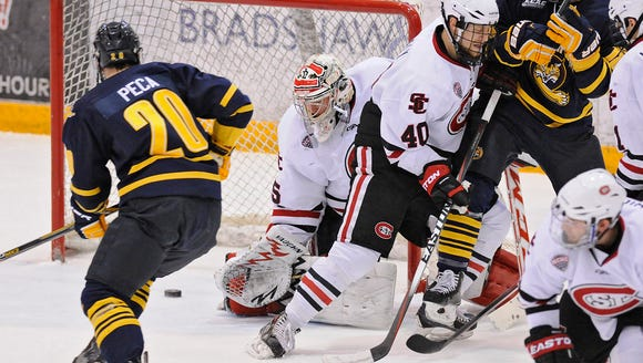 The puck gets past St. Cloud state goaltender Charlie