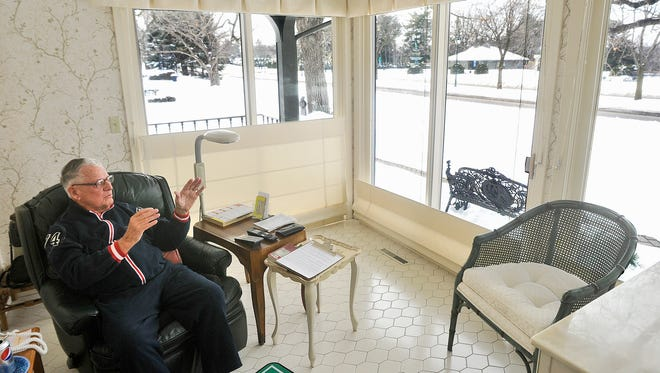 Philanthropist Bill Clemens, then 92, looks out on Clemens Gardens from a sun porch on his home on Kilian Boulevard in February 2013. Clemens bought the land across the street and funded the creation of the well-known garden in partnership with the city of St. Cloud.