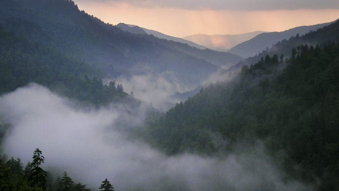 Sunset lights the western sky as fog fills the valley just west of Newfound Gap in the Great Smoky Mountains National Park.