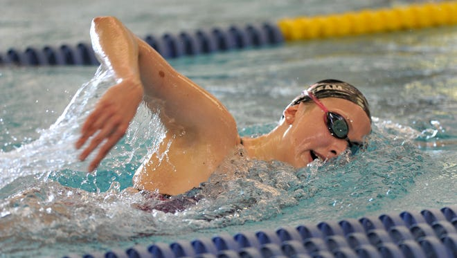 Amy Bilquist, who swam backstroke and freestyle for the Carmel Swim Club, practicing at the Carmel High School natatorium.