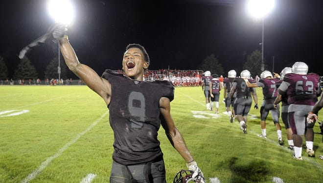 Liberty's Saidrick Pewitte (9) celebrates the Crusaders' 20-16 victory over Henry County on Aug. 19.