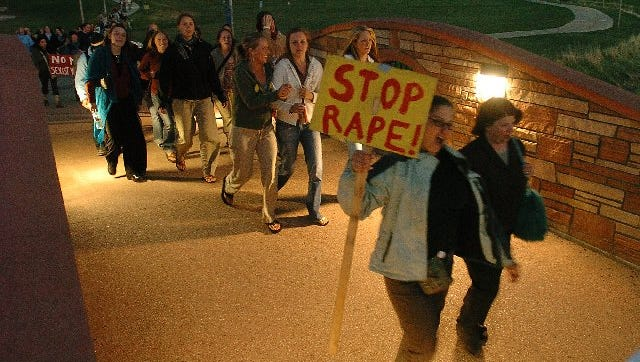 Take Back the Night marchers cross the bridge on Colorado State University campus during the 15th annual march in this 2006 file photo.