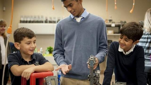 Senior Prakhar Nair (center) works with Lower School students.