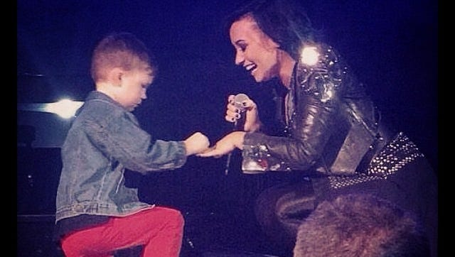Grant proposes to Demi Lovato on stage.