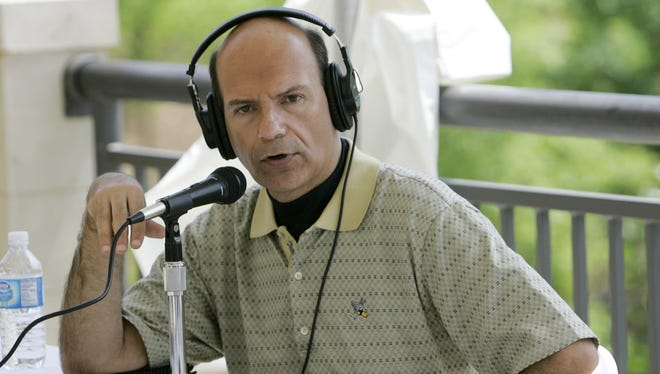 Radio host Paul Finebaum conducts his radio show in Hoover, Ala.